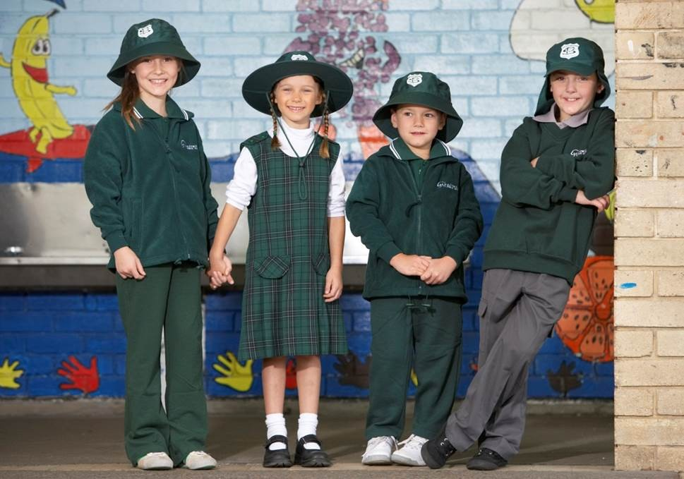 Four children in various school uniform examples.